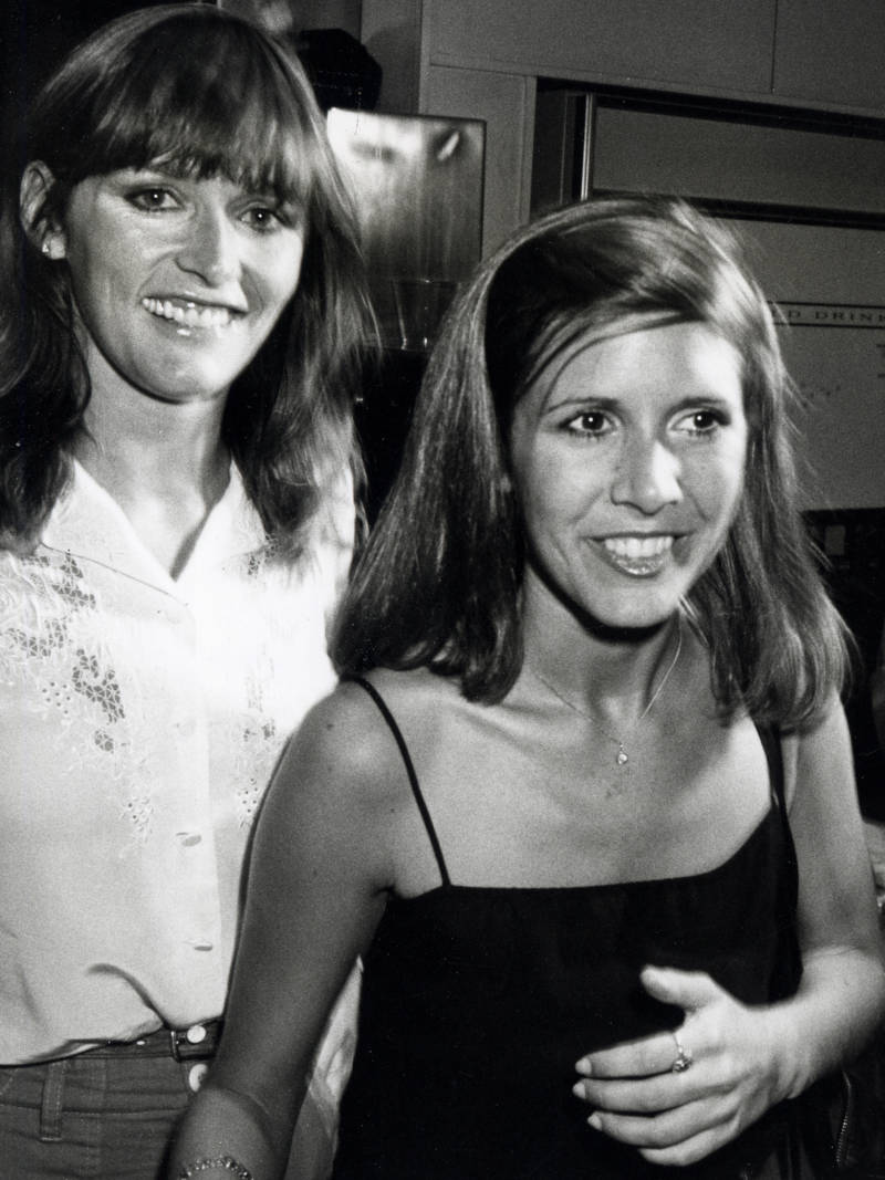 Margot Kidder is seen here with Carrie Fisher, as the two attended a fundraiser in 1980, at the Empire State Building in New York City. Fisher died in December of 2016.