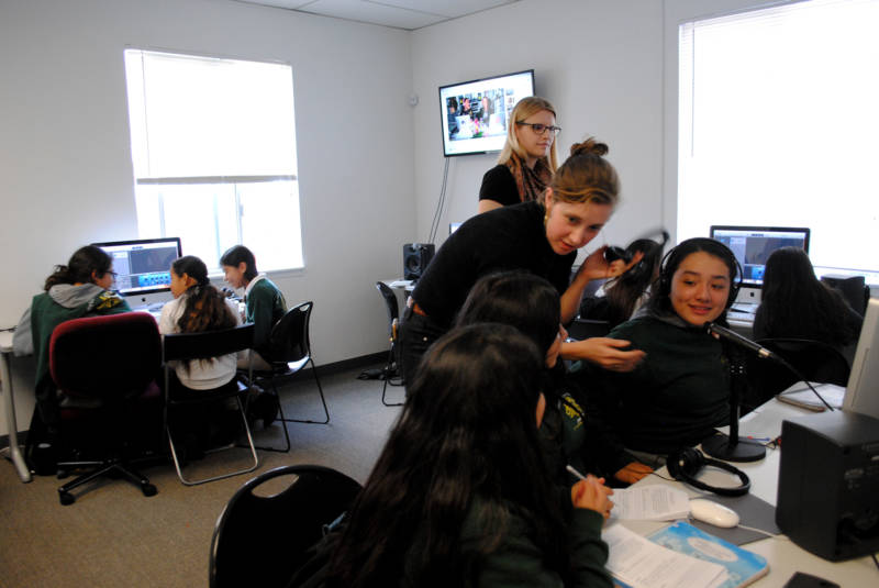 Women's Audio Mission interns assist in a podcasting class for middle schoolers at the non-profit's Oakland facility.