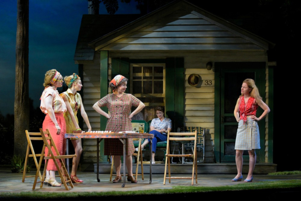 (L–R) Bunny (Molly Hager), Rhoda (Monique Hafen), Eleanor (Ariela Morgenstern), and Pearl (Katie Brayben) get together for an afternoon of mah-jongg in the world-premiere musical, 'A Walk on the Moon.' Background: Marty's mother, Lillian (Kerry O'Malley).