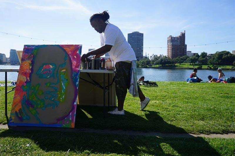 Jamaica the Artist painting at Lake Merritt.