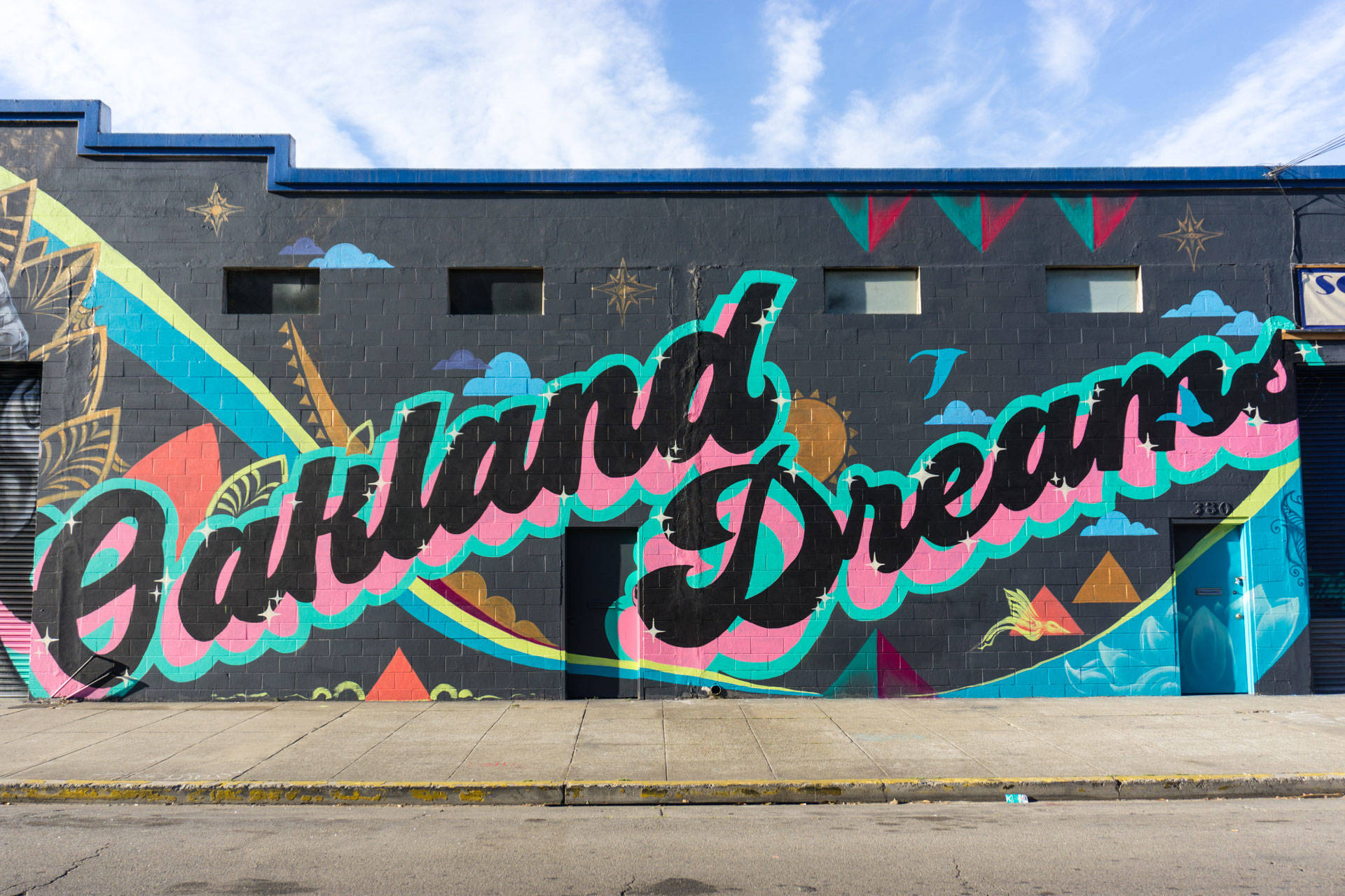 Oakland Dreams mural by Trust Your Struggle Collective as part of Oakland Mural Festival 2018. Lina Blanco / KQED