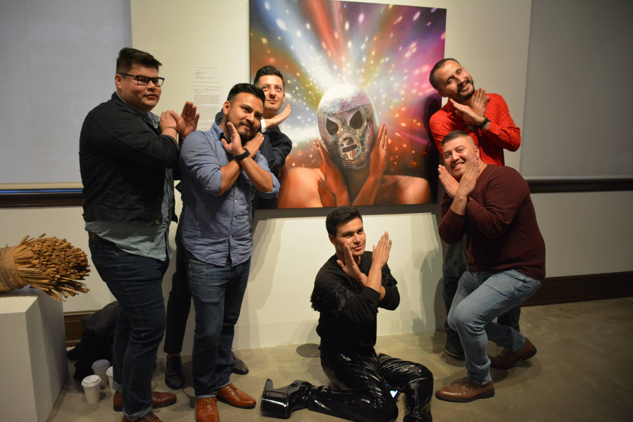 Orlando de la Garza with his painting and friends at the SFAC gallery.