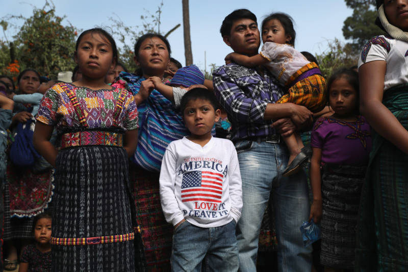 Families attend a memorial service for two boys who were kidnapped and killed on Feb. 14, 2017, in San Juan Sacatepequez, Guatemala. Such crimes have driven emigration from Guatemala to the United States, as families seek refuge from the violence.