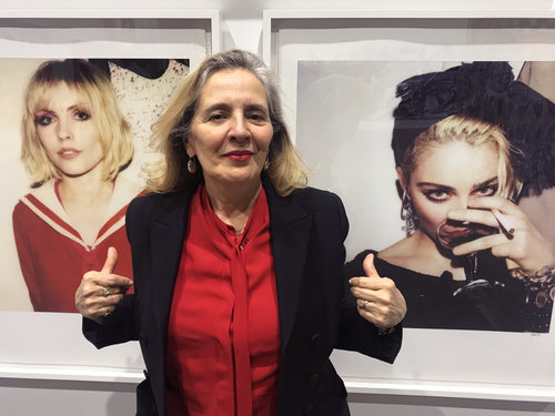 Maripol styled Blondie for the Parallel Lines album cover and Madonna for the Like a Virgin album cover. She appears here in front of her photographs at 'Beyond the Streets.'