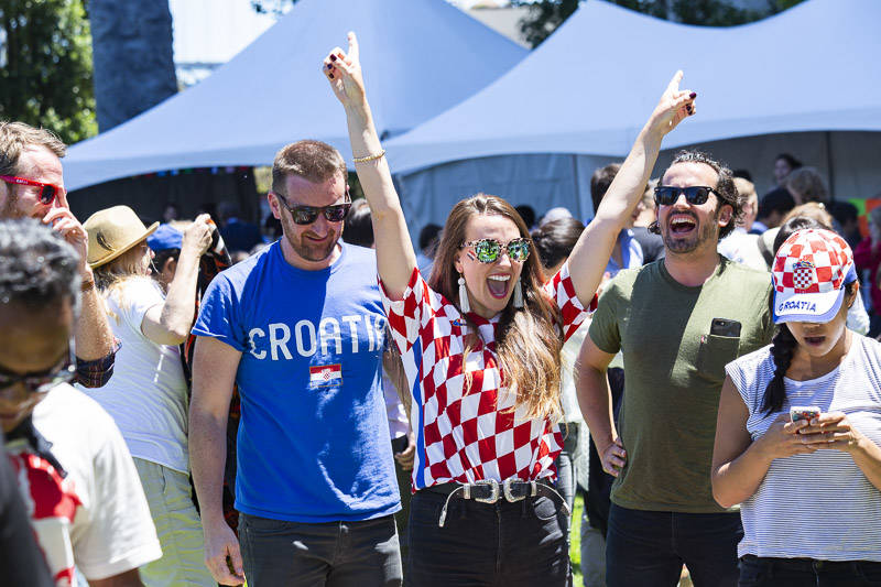 Ivana Zubonja, Julia Wu and friends celebrate Croatia's win at the World Cup Semi-final Viewing Party on Wednesday, July 11 at Sue Bierman Park in San Francisco.