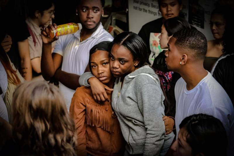 People attend a vigil for Nia Wilson at MacArthur BART in Oakland, July 23, 2018.