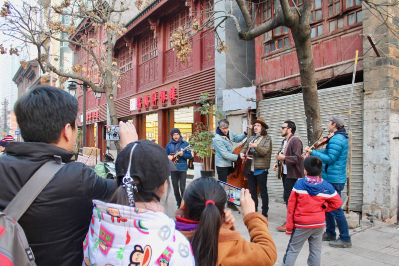 The Brothers Comatose perform on the street in Kunming, China.