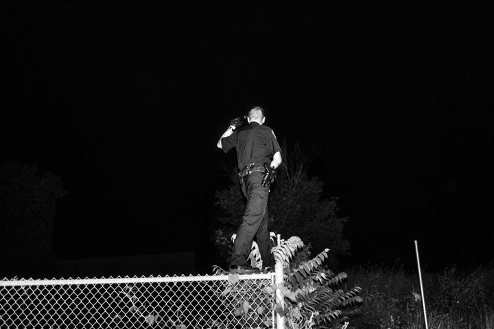 Paolo Pellegrin, 'A police officer. Northeast Rochester, NY,' 2013.