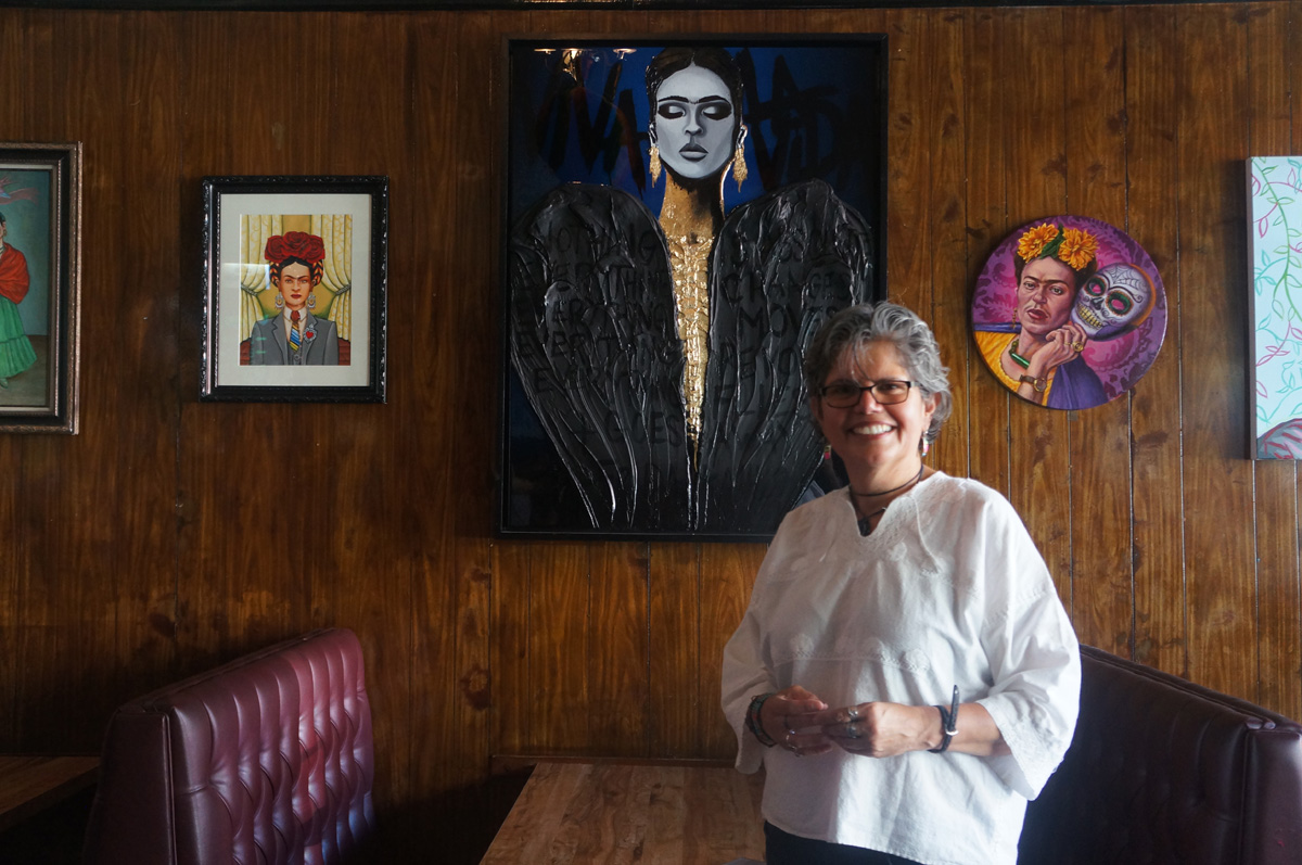 Amparo Vigil, one of Puerto Alegre's co-owners, in front of the Frida Kahlo tribute show she organized.