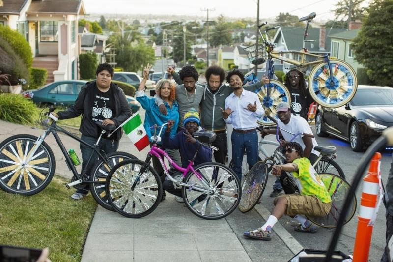 Tessa Thompson, Lakeith Stanfield, Boots Riley and Jermaine Fowler from the cast of 'Sorry to Bother You' with members of the Scraper Bike team in Oakland.