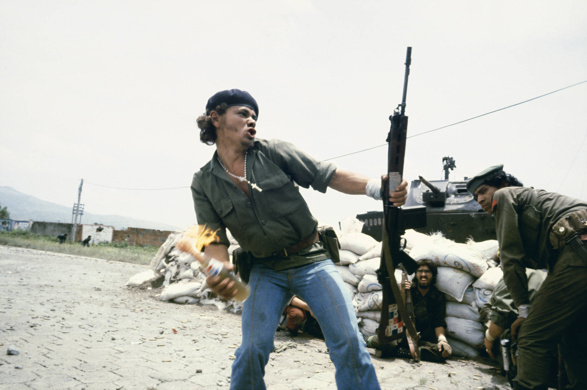"Susan Meiselas, 'Sandinistas at the walls of the Estelí National Guard headquarters, ""Molotov Man,"" Estelí, Nicaragua, July 16, 1979,' 1979."