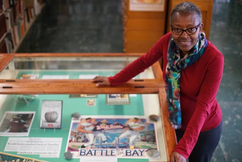 The Oakland Library's Dorothy Lazard with an exhibition commemorating the A's 50 years in Oakland.