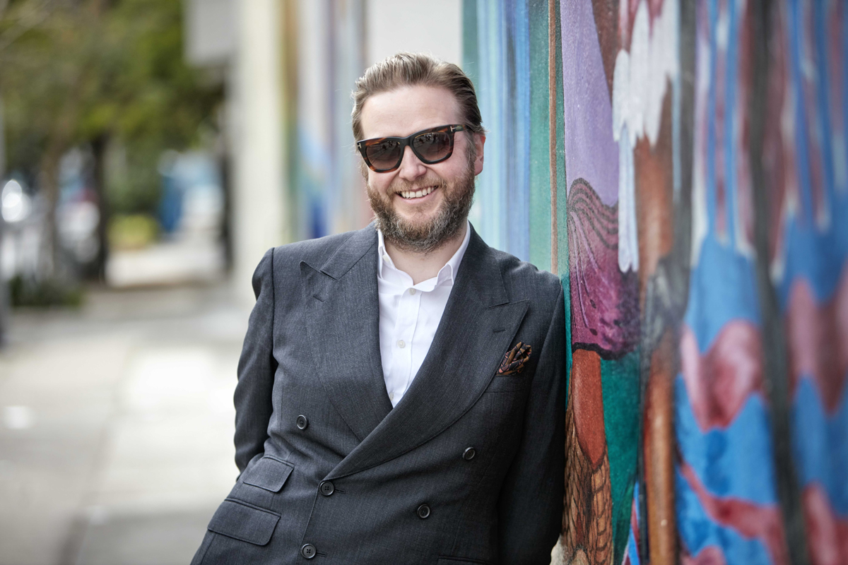 Ragnar Kjartansson in front of the 'MaestraPeace Mural,' The San Francisco Women's Building.