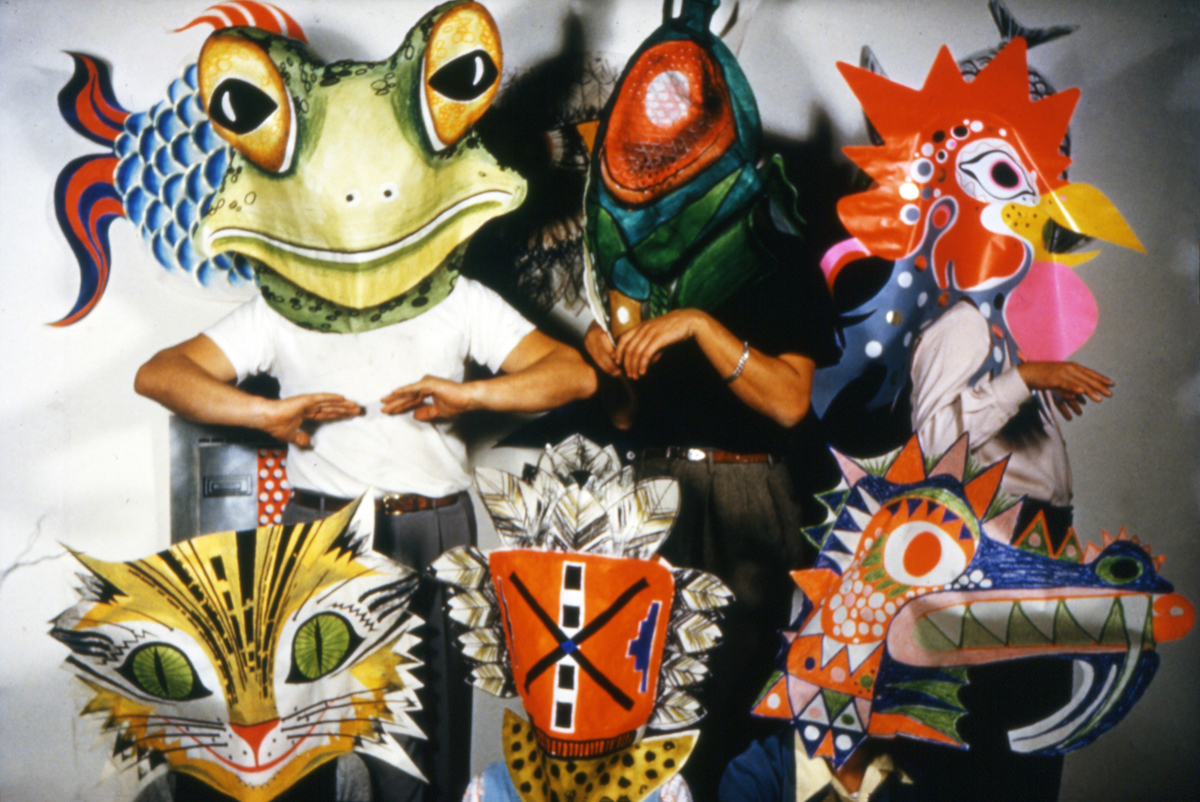 Eames Office staff wearing prototype toy masks, 1950.
