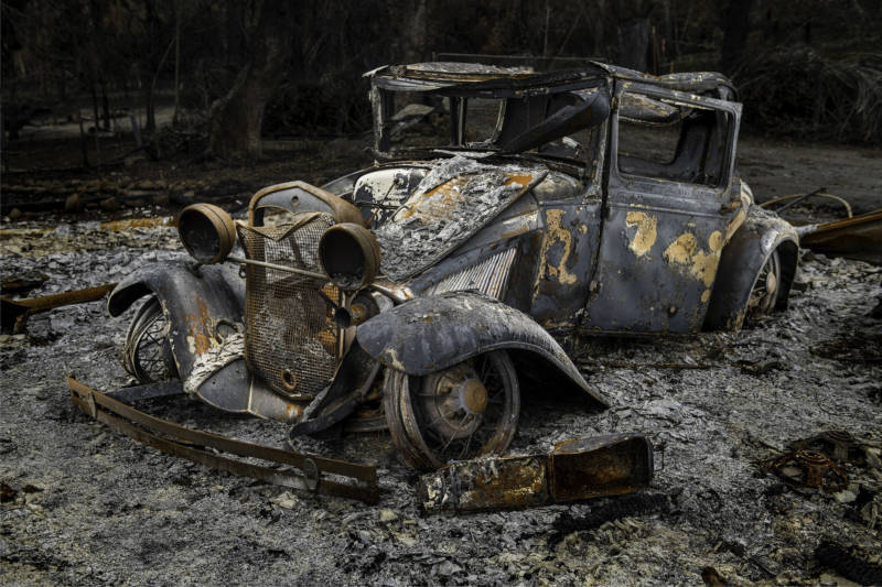 The wreckage from a burnt out vintage Chevy encapsulates what was lost in the Wine Country wildfires of 2017.