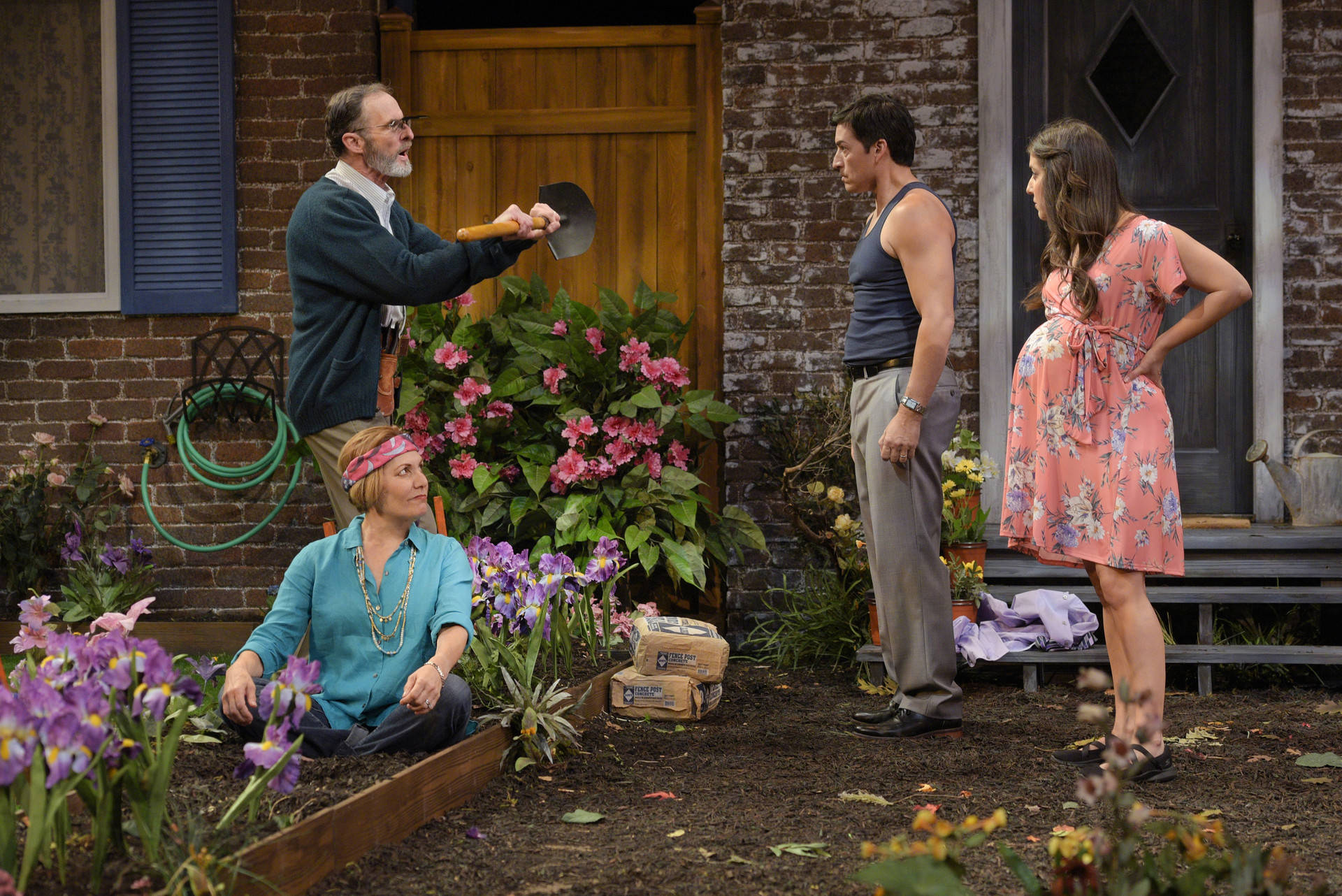 Neighbors Pablo (Michael Evans Lopez), Virginia (Amy Resnick), Tania (Marlene Martinez) and Frank (Jackson Davis) get testy with each other in 'Native Gardens' by Karen Zacarías presented by TheatreWorks Silicon Valley. Courtesy of Kevin Berne
