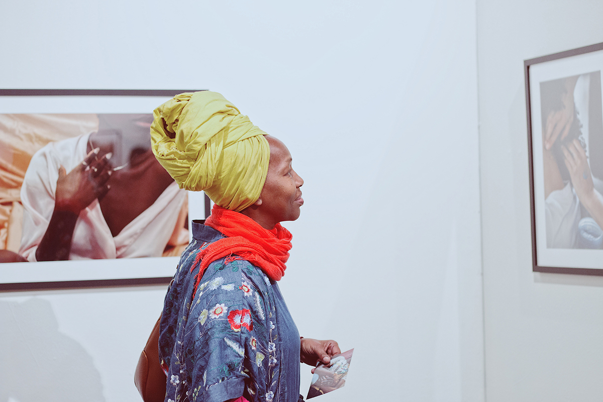 A gallery visitor during the opening of Kierra Johnson's photography exhibition 'Signify' at Betti Ono.
