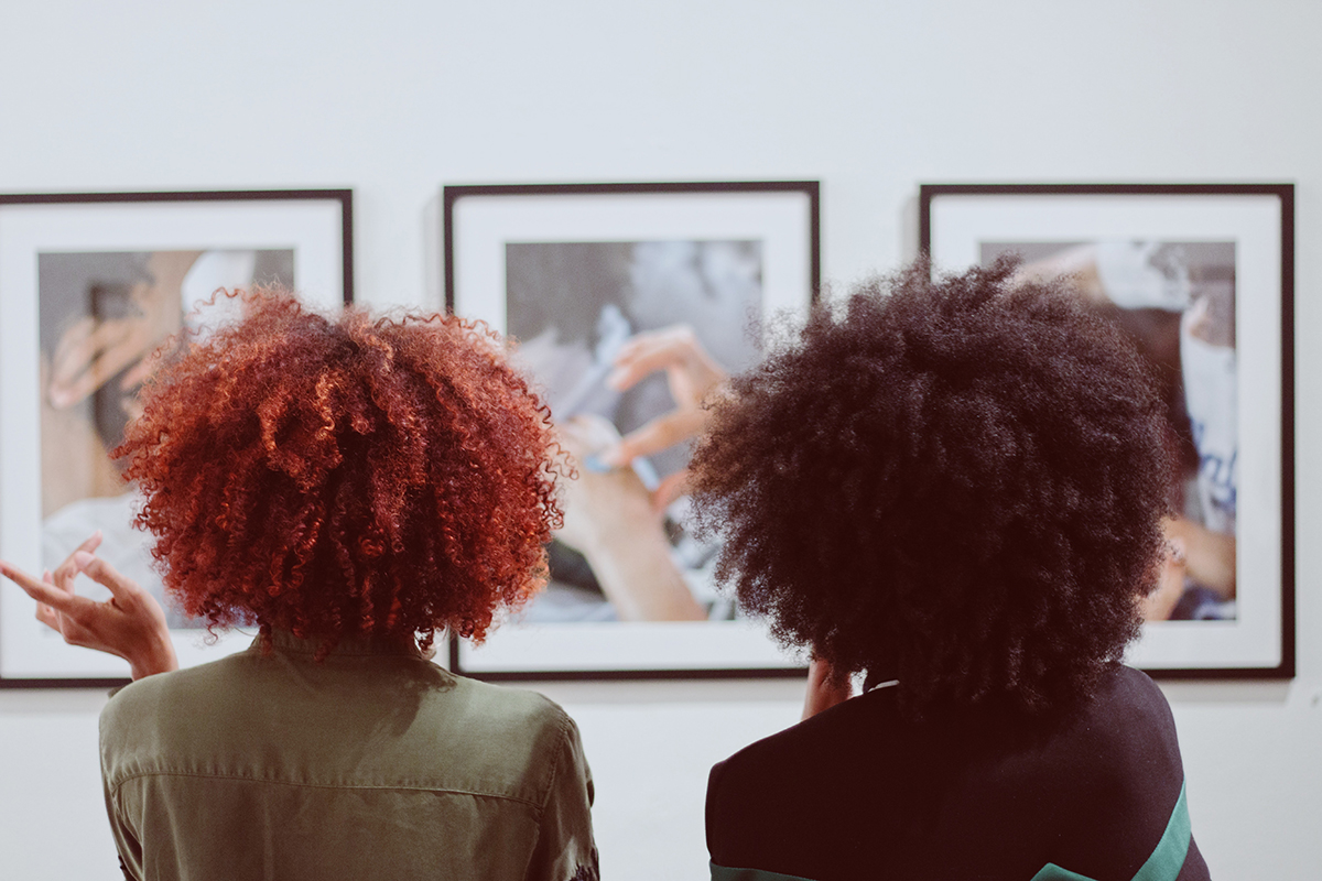 Gallery visitors during the opening of Kierra Johnson's photography exhibition 'Signify' at Betti Ono.