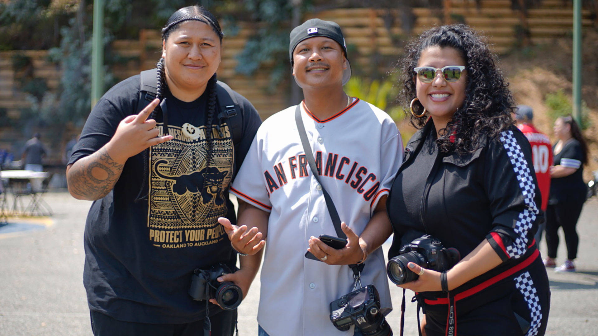 Jean Melesaine, left, with friends at the 'All My Usos' barbecue at Gilman Park in Bayview / Hunters Point. Pendarvis Harshaw