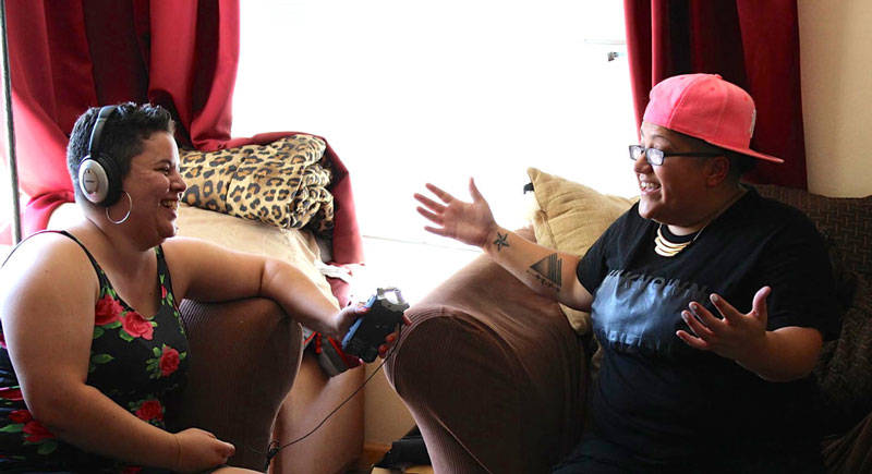Photo of Nia interviewing Gabby Rivera for her podcast 'We Want the Airwaves.'