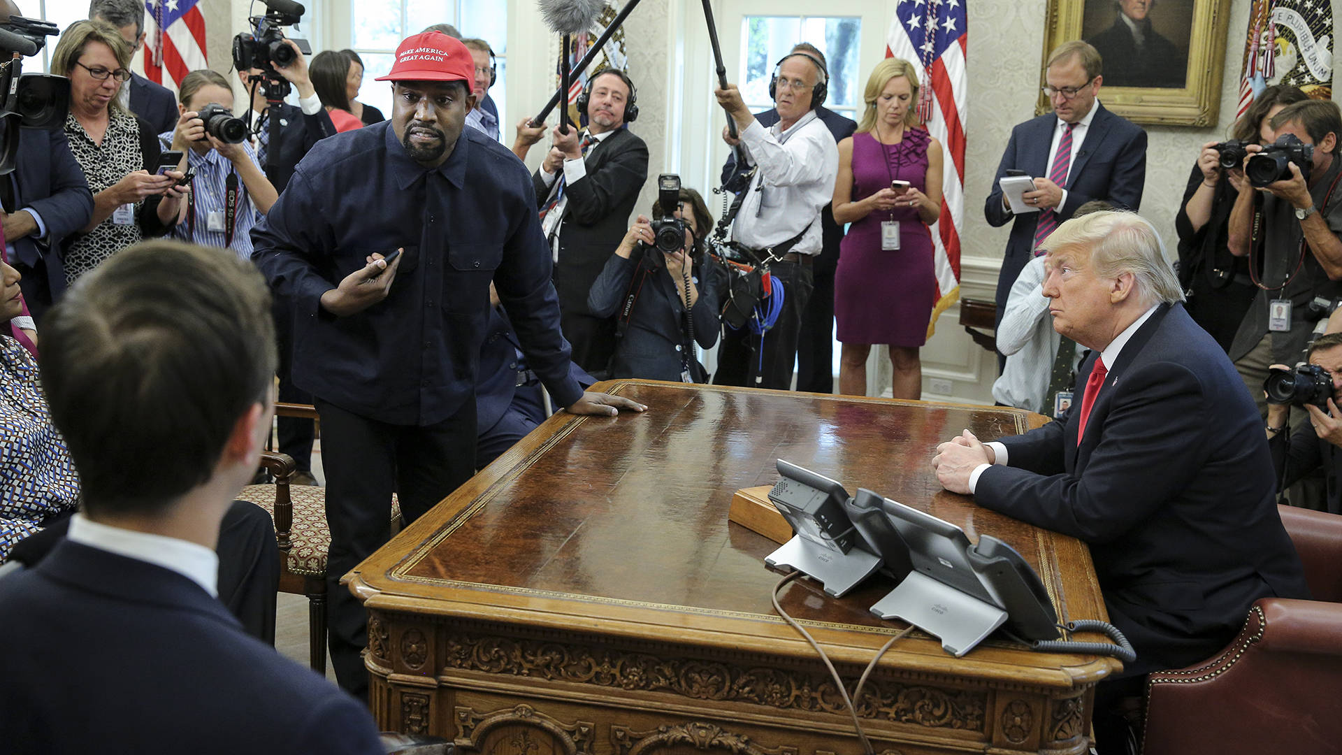 Kanye West stands up as he speaks during a meeting with Donald Trump in the Oval office of the White House on October 11, 2018 in Washington, DC.  Oliver Contreras - Pool/Getty Images