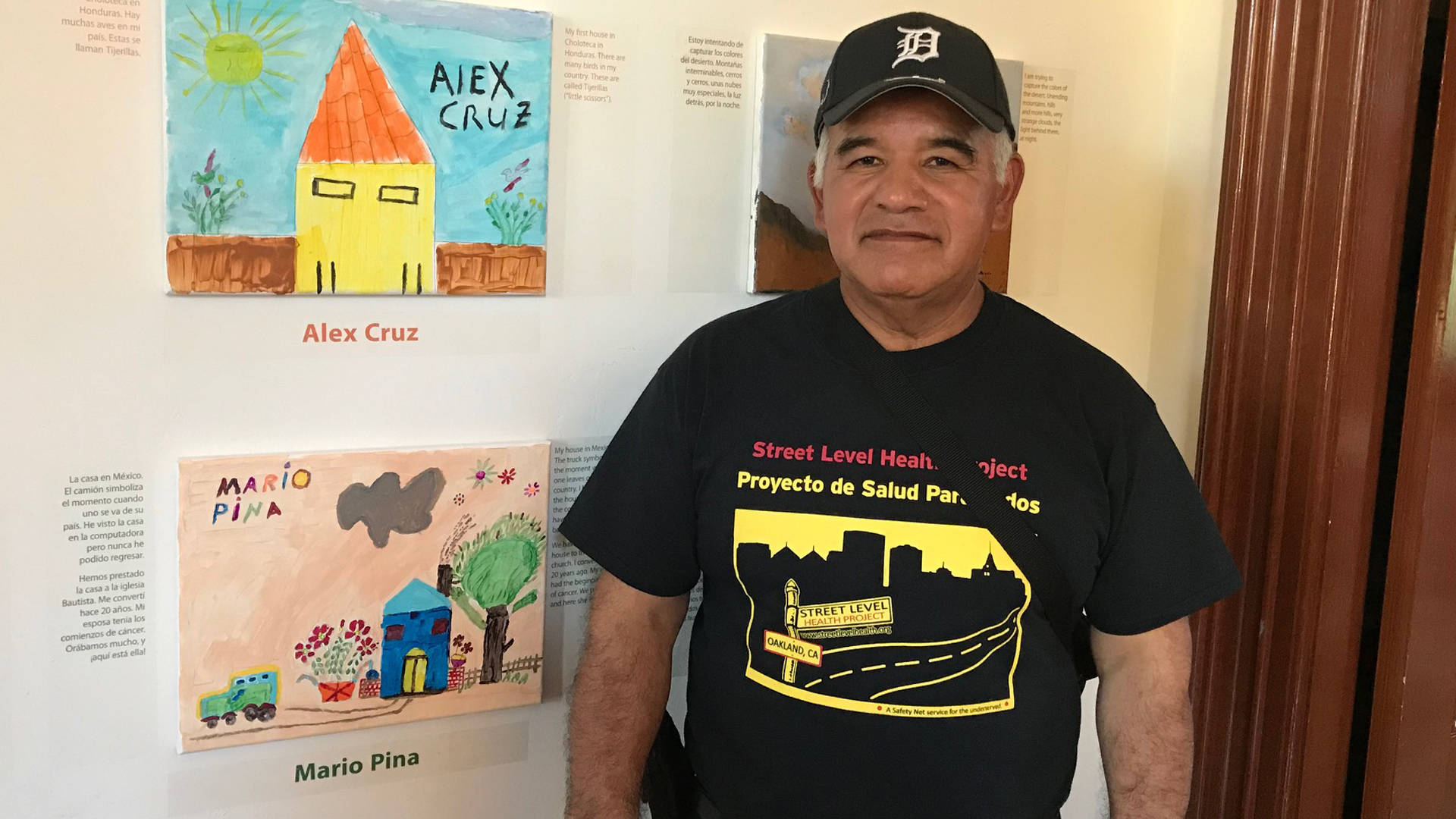 Mario Pina stands next to his painting in 'Undocumented Heart.' Azucena Rasilla