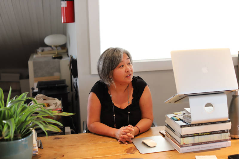 Lonnie Lee at her desk in Vessel Gallery. The landlord for the building in Oaklan'ds Uptown neighborhood has declined to renew Vessel Gallery's lease.