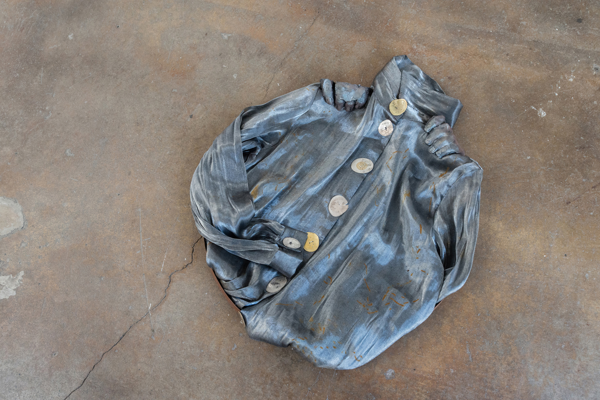 Jenine Marsh, 'contortion (steel),' 2018; Found metal ring, rust-stained blouse, train-flattened and drilled coins of mixed currencies, wire, gypsum cement, powdered pigment.