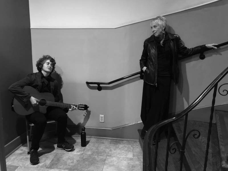 Anne Carol Mitchell performs at 'Romantic Songs of the Patriarchy' while Laurie Lewis looks on at the Women's Building in San Francisco.