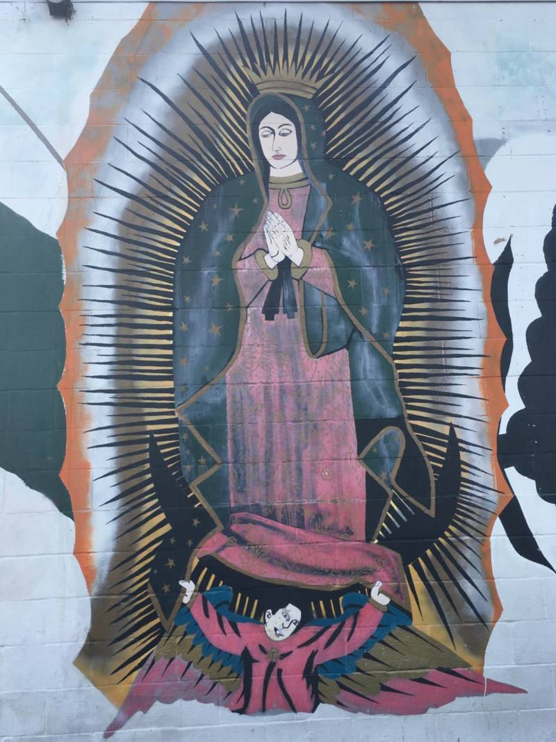 What's left of a larger mural that included the Virgen de Guadalupe by an unknown artist on the wall of Cal Foods Tienda y Carniceria in the Five Wounds neighborhood of San Jose.