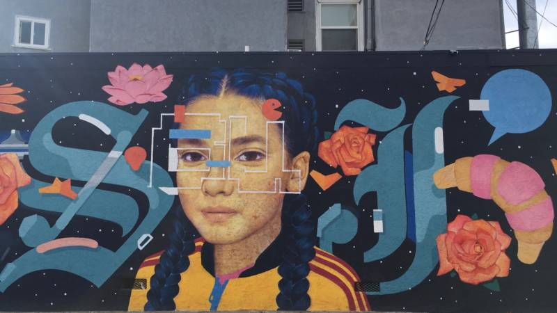 "Detail of ""Here & There"" by Sam Rodriguez in San Jose's Japantown. The more you look, the more you see, like the letters ""S"" and ""J"" in Olde English font on either side of his daughter's face. You know: SJ, for San Jose."