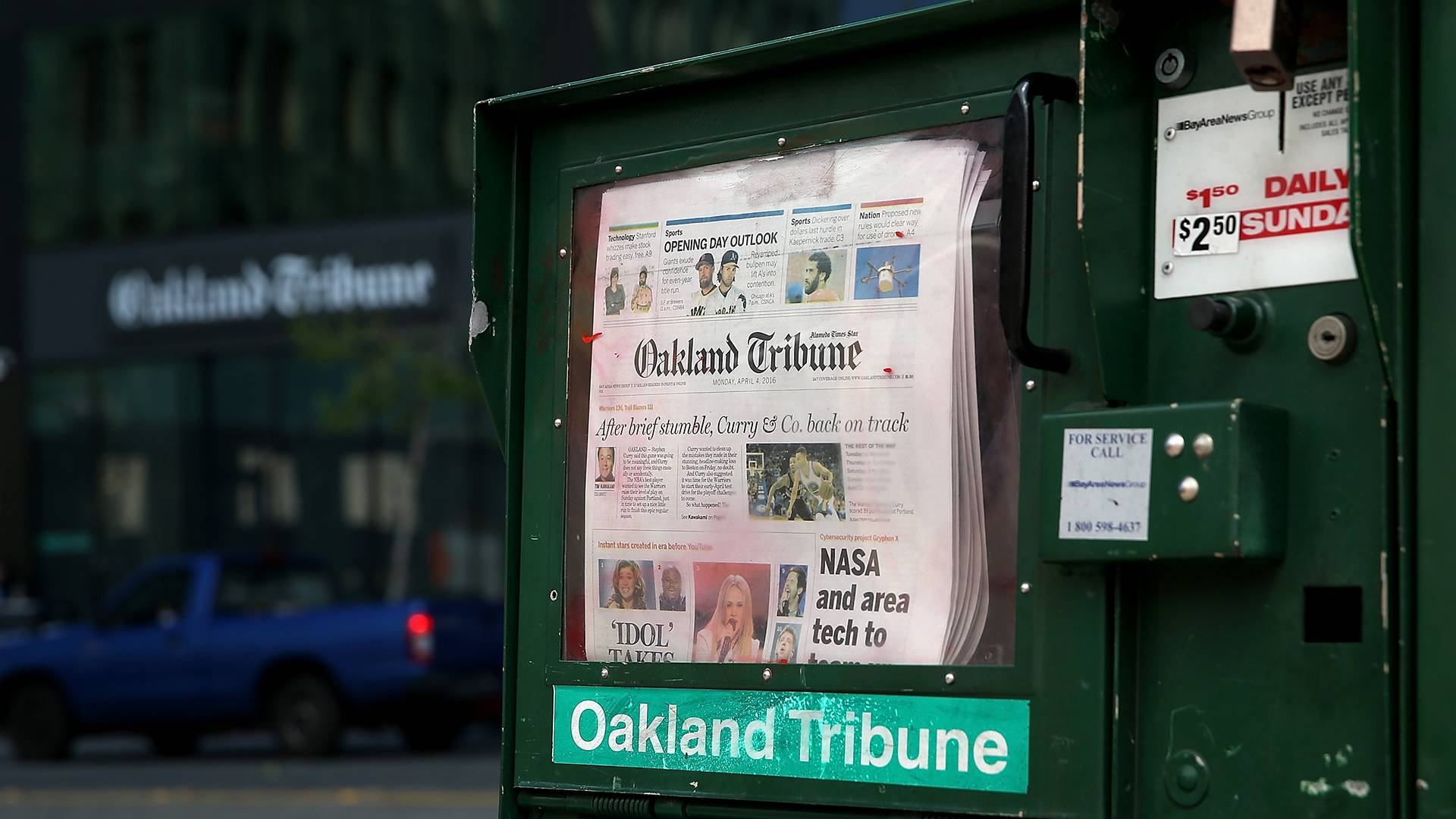 The final edition of the Oakland Tribune is displayed in a newspaper rack in front of the Oakland Tribune offices on April 4, 2016. Justin Sullivan/Getty Images