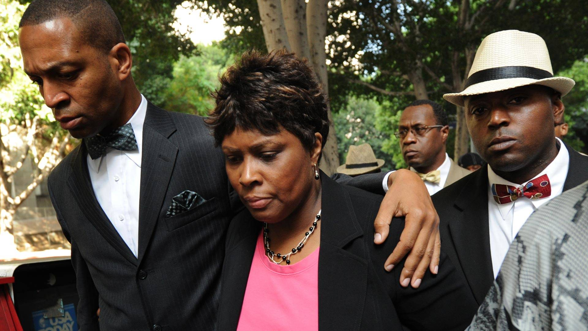 Wanda Johnson (center), the mother of Oscar J. Grant III, walks with supporters as they leave the Los Angeles Superior Court after the involuntary manslaughter verdict against former Bay Area Rapid Transit (BART) officer Johannes Mehserle, in Los Angeles on July 8, 2010. MARK RALSTON/AFP/Getty Images