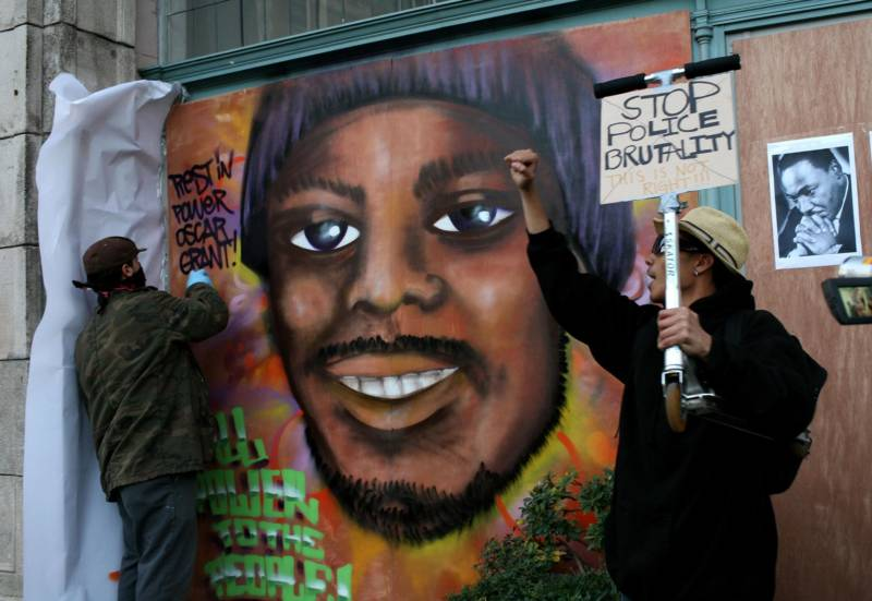 Protestors paint a mural of slain 22-year-old Oscar Grant III Jan. 14, 2009 in Oakland.