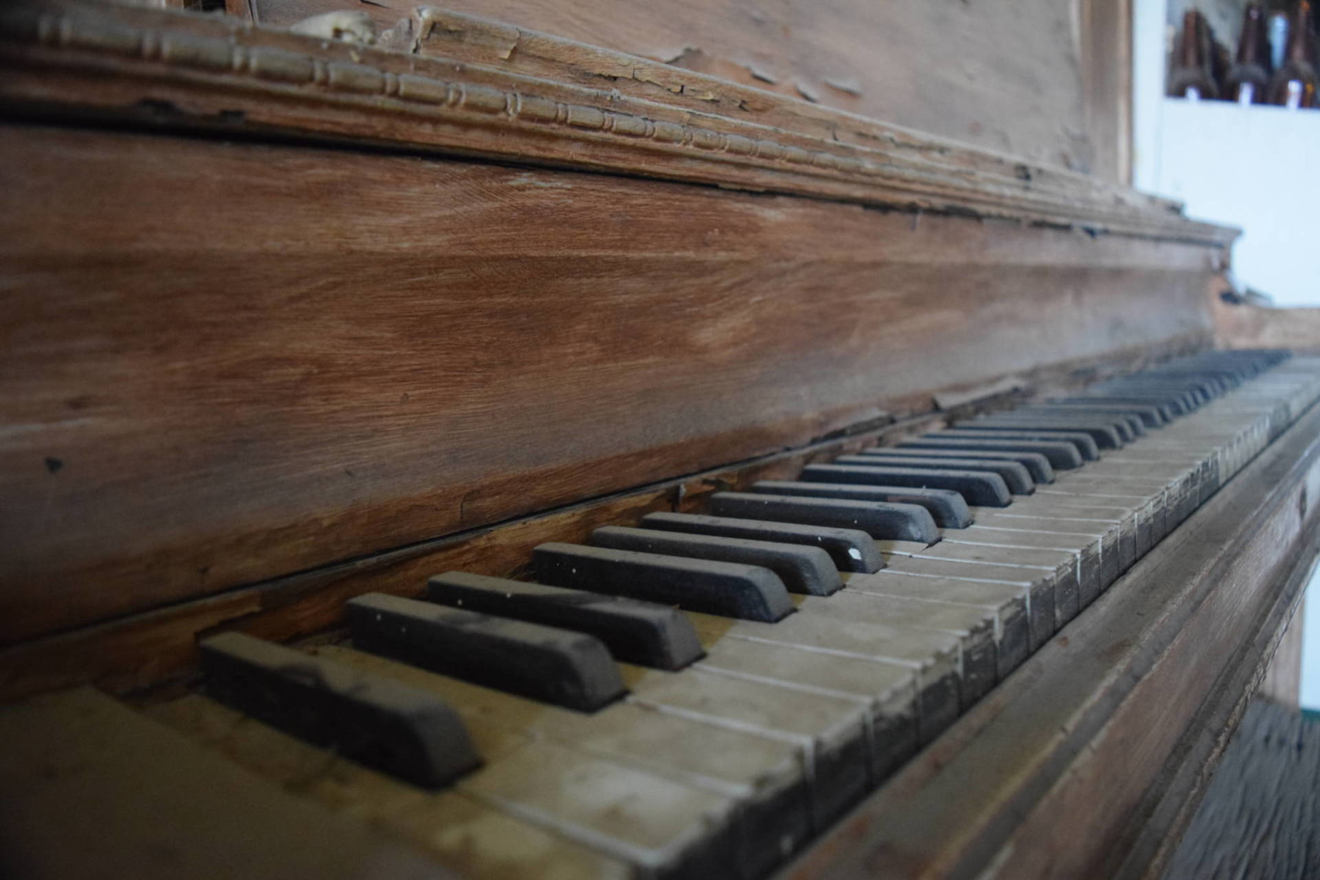 A piano lies dusty in the ghost town of Bodie—one of the subjects of this year's most-heard podcasts from KQED. Carly Severn/KQED