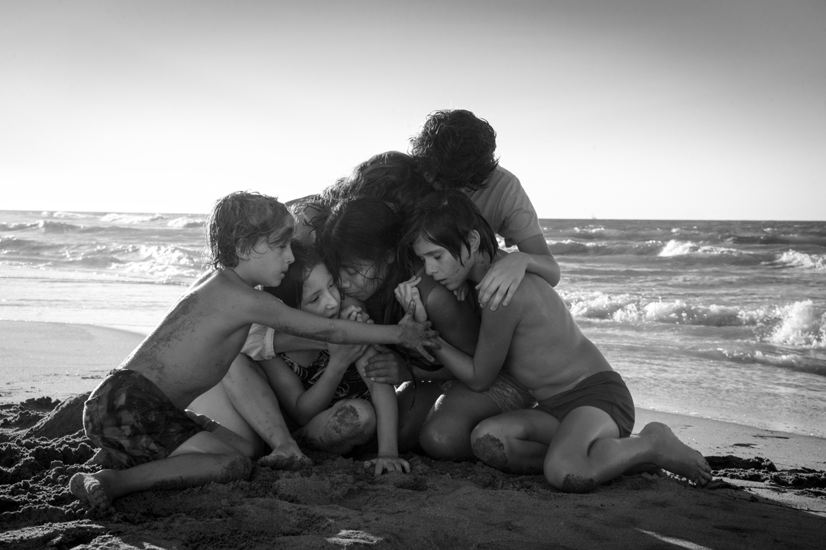 (L to R) Marco Graf as Pepe, Daniela Demesa as Sofi, Yalitza Aparicio as Cleo, Marina De Tavira as Sofia, Diego Cortina Autrey as Toño, Carlos Peralta Jacobson as Paco in 'Roma,' written and directed by Alfonso Cuarón.