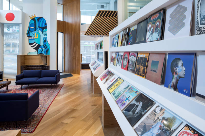 The first thing visitors encounter at Bandcamp's new office is a rotating display of 99 vinyl LPs.