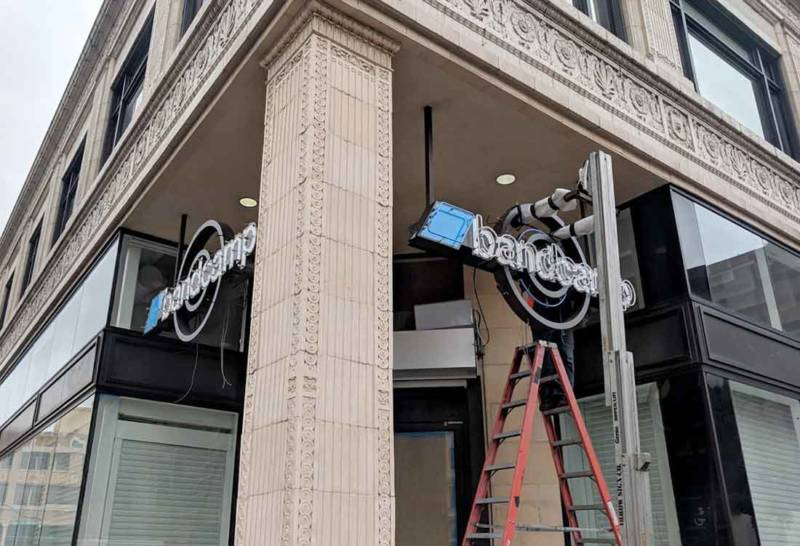Signage at Bandcamp's new Oakland offices goes up on Jan. 17, 2019.