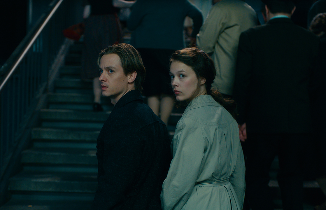 L to R: Tom Schilling as Kurt Barnert, Paula Beer as Ellie Seeband in 'Never Look Away.'