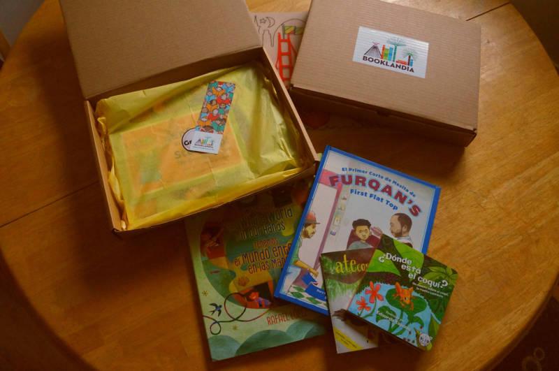 A Booklandia subscription box featuring Robert Trujillo's 'Furquan's First Flat Top,' Eduardo Espada's 'Donde Esta El Coqui' and more.