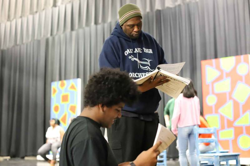 David Byrd consults with the pit band in rehearsals for 'Hairspray' at Oakland High School.