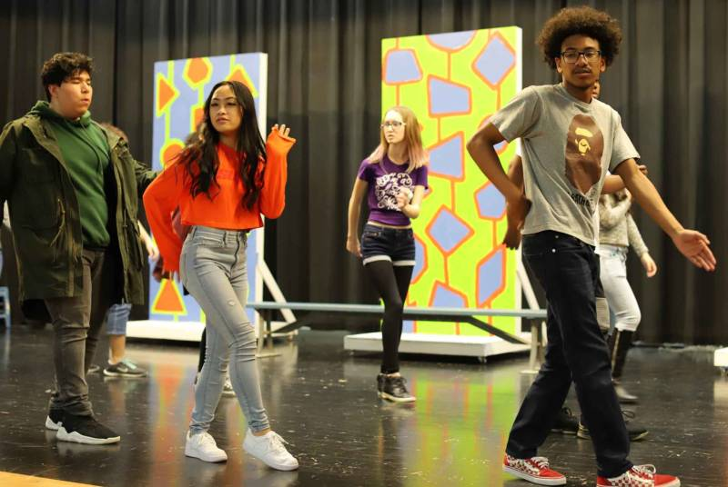 The cast of 'Hairspray' rehearses at Oakland High School.
