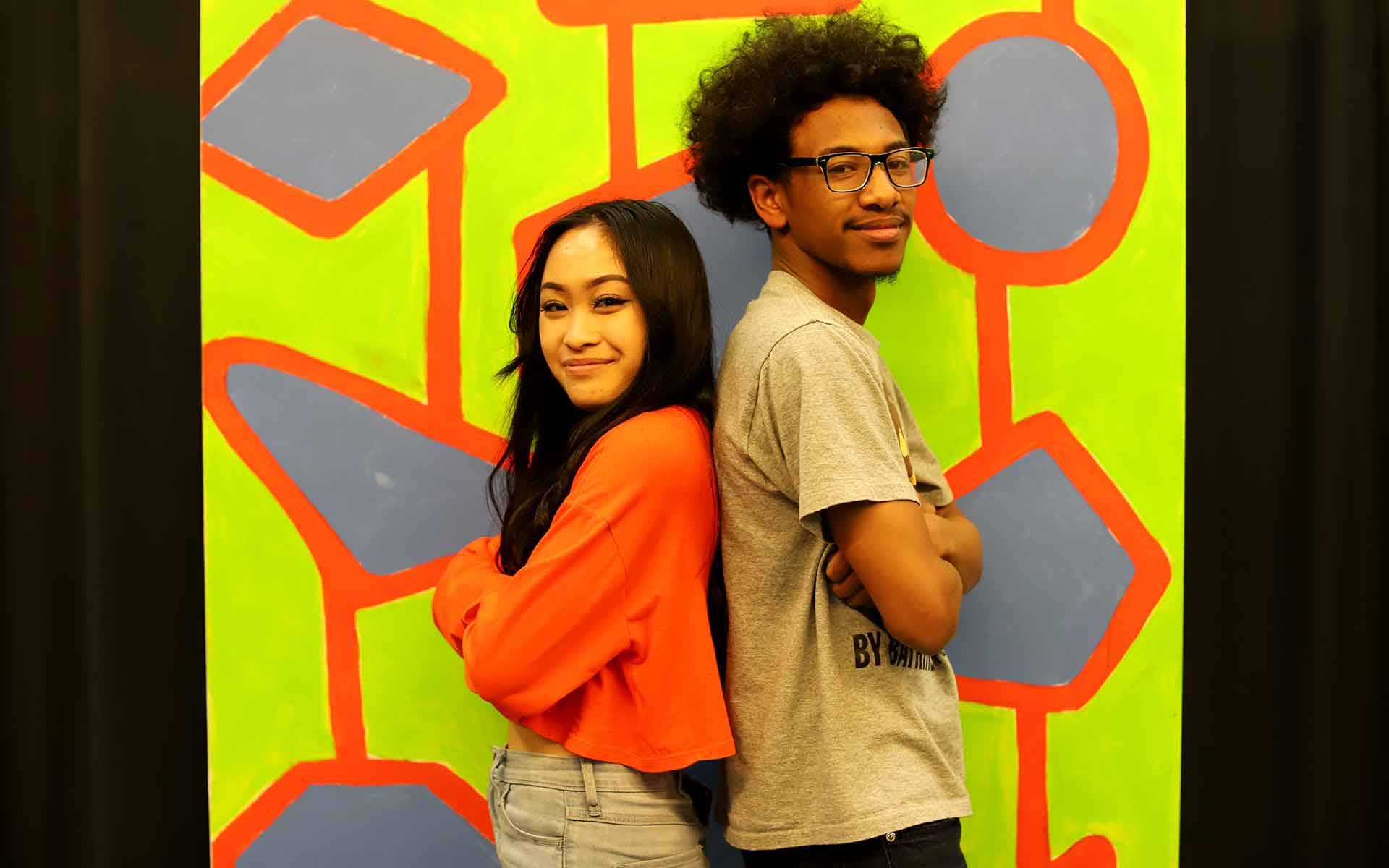 Trinity Chau and Trevahn Srey (L–R) are the two leads in 'Hairspray' at Oakland High School. The musical is in danger of being canceled due to the teachers' strike. Gabe Meline/KQED