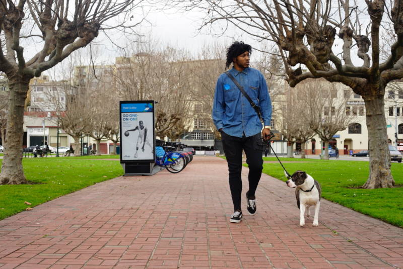 Tree Thomas in Oakland with his dog Chef.