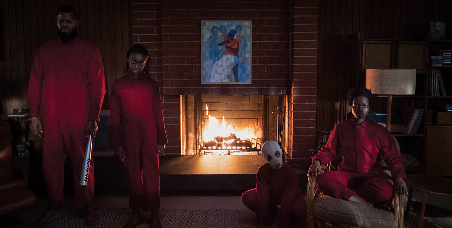 The Wilson family's doppelgängers (from left) Abraham (Winston Duke), Umbrae (Shahadi Wright Joseph), Pluto (Evan Alex) and Red (Lupita Nyong'o) in 'Us.'