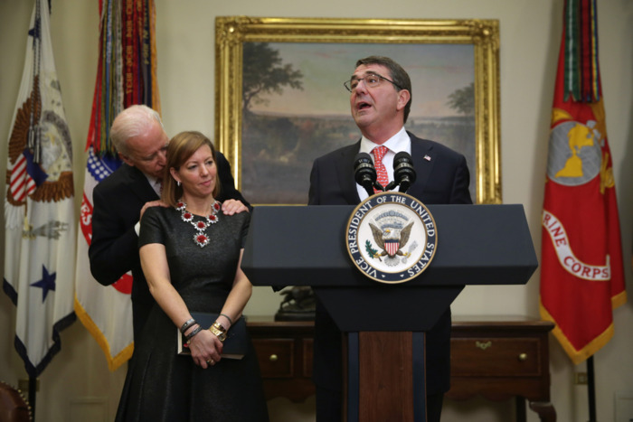 Joe Biden whispers in Christine Carter's ear in 2015.