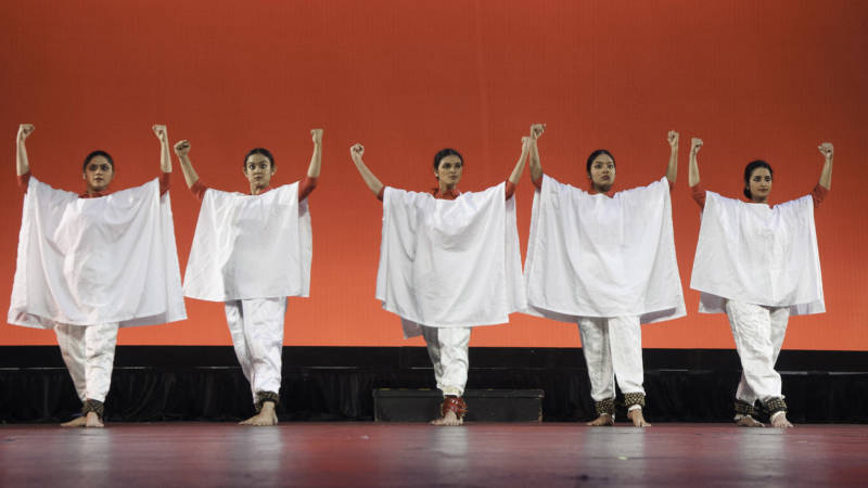 """Chaitanya Gotur, Manisha Roy, Hemavathy Arumugam, Rekha Nagarajan, and Vaishali Ramachandran perform Si Se Puede — """"Yes We Can,"""" the United Farm Workers' motto — about the life and activism of Cesar Chavez."""
