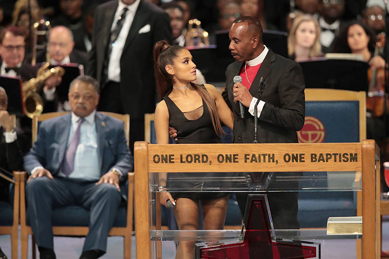 Singer Ariana Grande speaks with Bishop Charles Ellis III after performing at the funeral for Aretha Franklin at the Greater Grace Temple on August 31, 2018 in Detroit, Michigan.