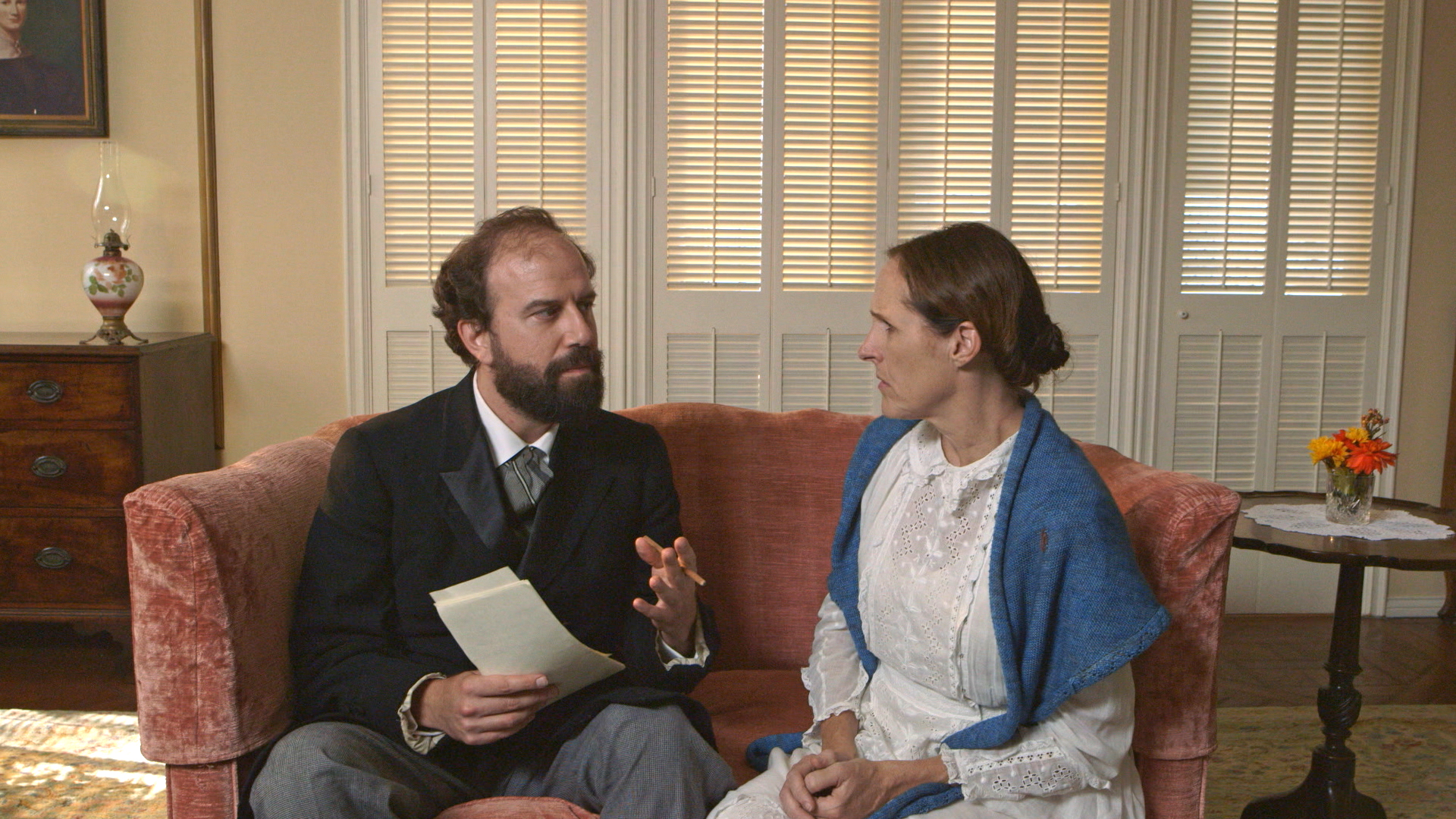 Higginson (Brett Gelman) takes a knife to Emily's poems in 'Wild Nights with Emily.'