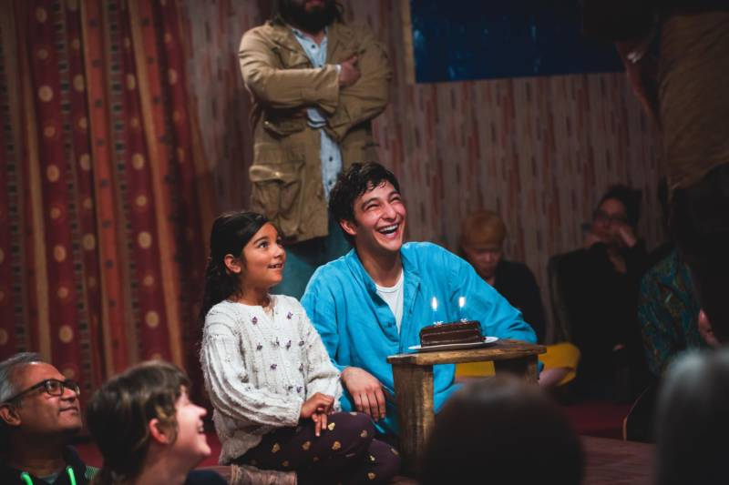 Little Amal (Arya Rose Lohmor) and Norullah (Khaled Zahabi) in 'The Jungle' at the Curran Theater.